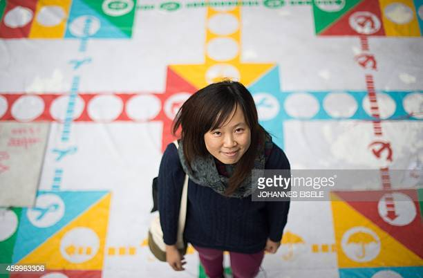 STORY 'HONG KONGCHINAPROTESTSDEMOCRACYLANGUAGE' FEATURE BY EMILY FORD In this picture taken on December 4 artist Helen Fan one of the founders of the...