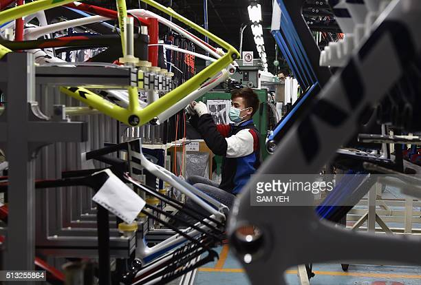 STORY 'TAIWANGIANTCYCLING' INTERVIEW In this picture taken on February 23 an employee of the world's biggest bicycle maker Giant Manufacturing Co...