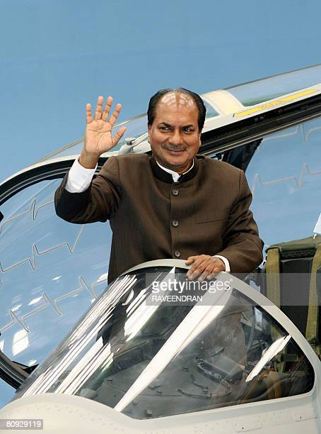 In this picture taken on February 23 Indian Defence Minister AK Antony waves as he stands in the cockpit of a Hawk Advanced Jet Trainer aircraft...