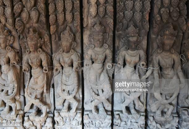 In this picture taken on February 8 artifacts are lined up in storage at Hanuman Dhoka Palace in Kathmandu Caretaker Deepak Shrestha padlocked shut...