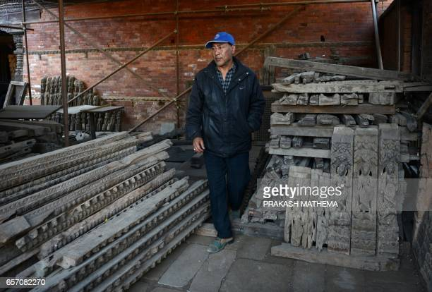 In this picture taken on February 8 Trilokya Mohan Narayan temple caretaker Deepak Shrestha looks at artifacts during a interview with AFP inDurbar...
