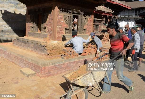 In this picture taken on February 8 workers renovate heritage sites at Durbar Square in Kathmandu Caretaker Deepak Shrestha padlocked shut the...