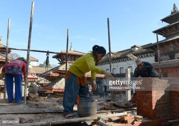 In this picture taken on February 8 workers renovate heritage sites in Durbar Square in Kathmandu Caretaker Deepak Shrestha padlocked shut the...