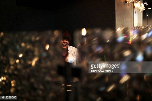 In this picture taken on January 23 a male host shares a laugh with his female customer at a host club in the Kabukicho redlight district in Tokyo...