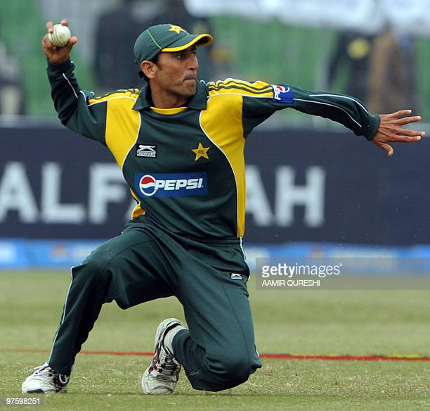 In this picture taken on January 24 Pakistani cricketer Younus Khan throws the ball during the third and final One Day International match between...