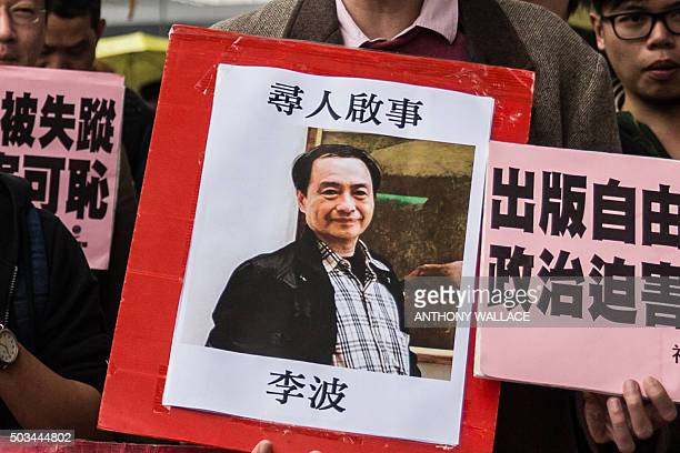 In this picture taken on January 3 a protestor holds up a missing person notice for Lee Bo the latest of five Hong Kong booksellers from the same...