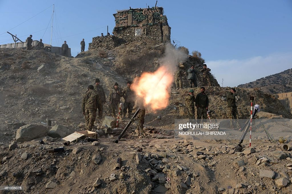 In this picture taken on January 3 Afghan National Army soldiers fire a 120mm mortar round during an ongoing antiTaliban operation in Dangam district...