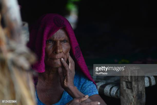 In this picture taken on July 10 Nargi mother of Mohan aged 30 who died of consuming poisonous alcohol mourns inside her temporary shelter in...