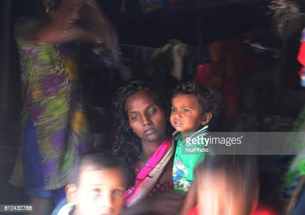 In this picture taken on July 10 Sunita wife of Mohan aged 30 who died of consuming poisonous alcohol criesinside her temporary shelter in kewatiya...
