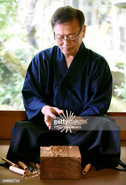 In this picture taken on July 4 Sabun Kubo head of Chikumeido makes a bamboo whisk used in traditional tea ceremonies during an interview at his...