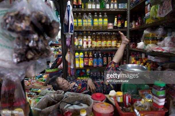 In this picture taken on July 7 a vendor takes a nap after the morning rush at a market where rice paper is sold in Can Tho in the Mekong Delta rice...