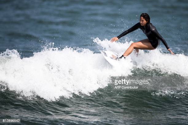 In this picture taken on July 8 Japanese surfer Minori Kawai rides a wave during a training session in the town of Ichinomiya Chiba prefecture Just...