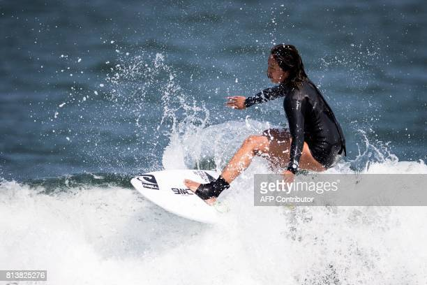 In this picture taken on July 8 Japanese surfer Minori Kawai rides a wave during a training session in the town of Ichinomiya Chiba prefecture Sweet...