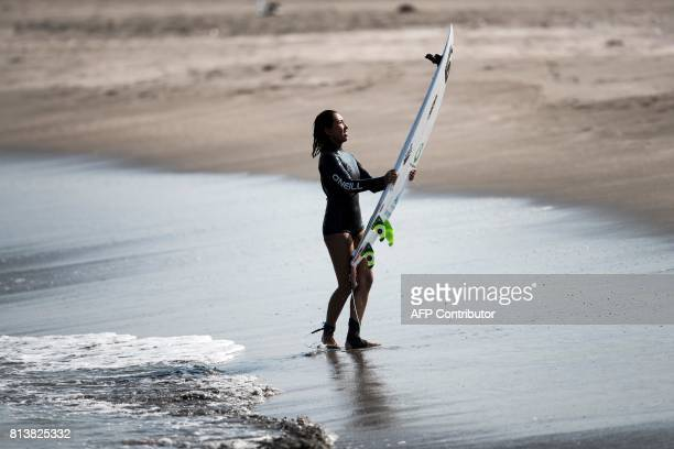 In this picture taken on July 8 Japanese surfer Minori Kawai smiles to the camera mounted on her surfboard after a training session in the town of...