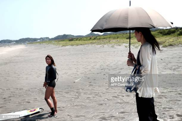In this picture taken on July 8 Japanese surfer Minori Kawai speaks with her mother Asuka before a training session in the town of Ichinomiya Chiba...