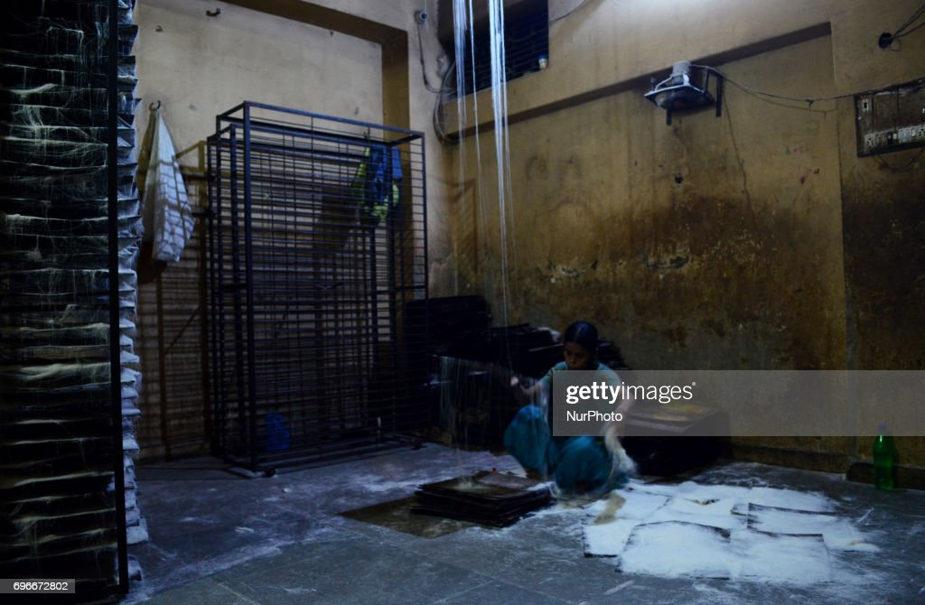 In this picture taken on June 16,2017,An Indian woman worker prepares vermicelli,a traditional sweet dish , ahead of Eid Al Fitr festival , at a factory , in the old streets of Allahabad. Muslims throughout the world are marking the month of Ramadan, the holiest month in the islamic calender.Eid Al -Fitr (feast of breaking the fast) is an important religious festival celebrated by muslims worldwide that marks the end of Ramadan, the islamic holy month of fasting.