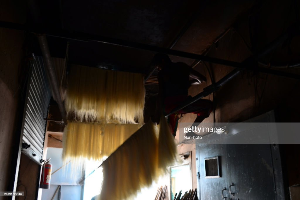 In this picture taken on June 16,2017,An Indian worker dries vermicelli,a traditional sweet dish , ahead of Eid Al Fitr festival , at a factory , in the old streets of Allahabad. Muslims throughout the world are marking the month of Ramadan, the holiest month in the islamic calender.Eid Al -Fitr (feast of breaking the fast) is an important religious festival celebrated by muslims worldwide that marks the end of Ramadan, the islamic holy month of fasting.