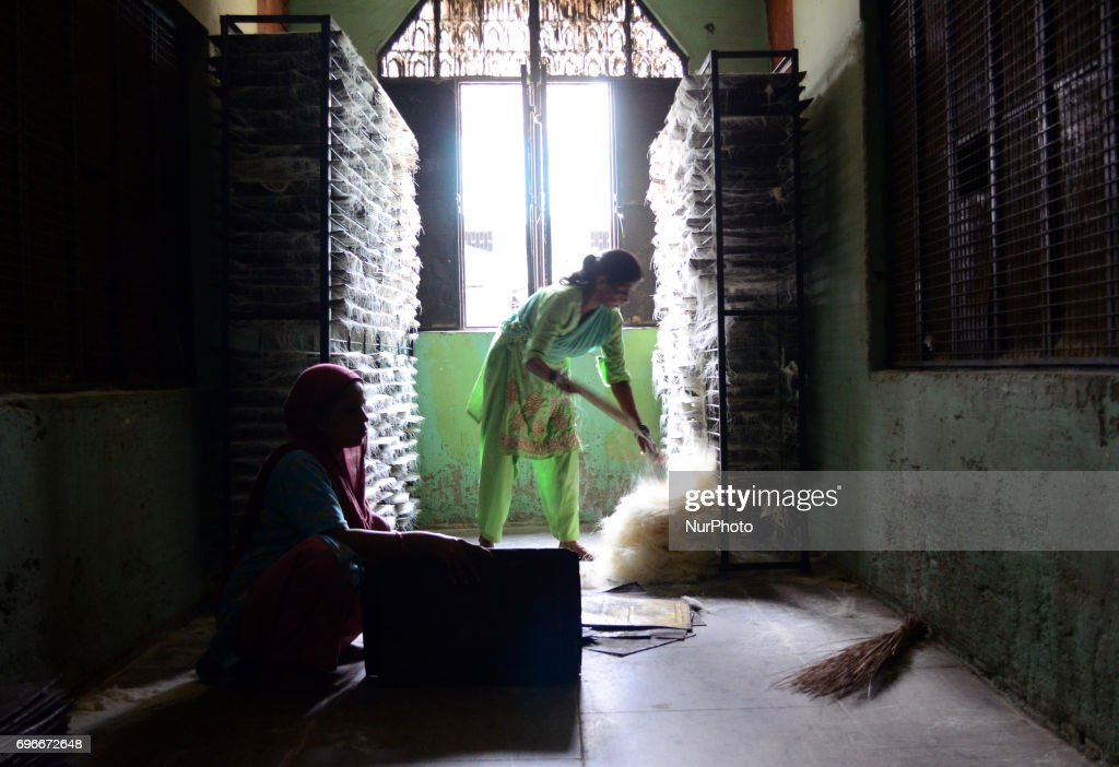 In this picture taken on June 16,2017, Indian women workers dry vermicelli,a traditional sweet dish , ahead of Eid Al Fitr festival , at a factory , in the old streets of Allahabad. Muslims throughout the world are marking the month of Ramadan, the holiest month in the islamic calender.Eid Al -Fitr (feast of breaking the fast) is an important religious festival celebrated by muslims worldwide that marks the end of Ramadan, the islamic holy month of fasting.