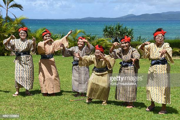 In this picture taken on June 22 an elderly women troupe of singers and dancers from Kohama Island in Okinawa wearing traditional local costumes...