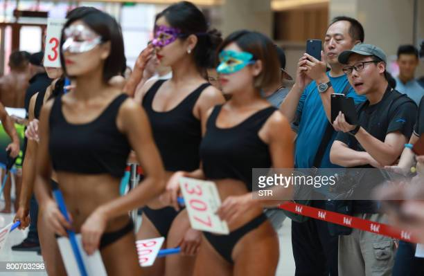 In this picture taken on June 24 2017 participants take part in the 'Women's Beautiful Buttock series' contest shopping mall in Shenyang Liaoning...