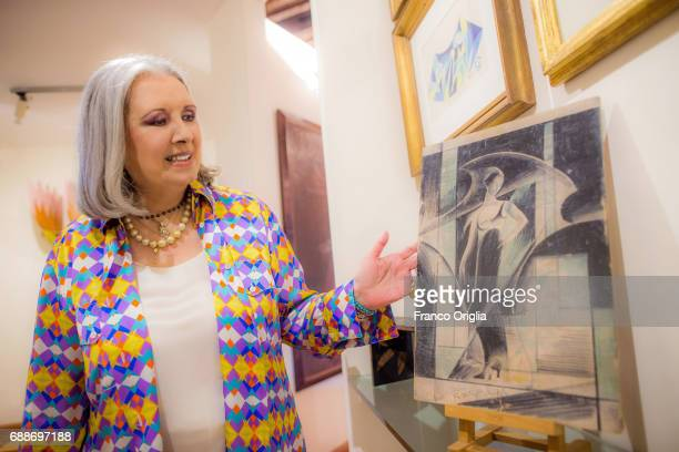 In this picture taken on June 4 2015 Italian stylist Laura Biagiotti poses at her Roman Villa with her private collection of futurist painter Giacomo...