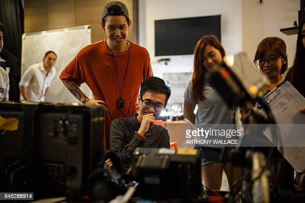 In this picture taken on June 7 recent graduate Crosby Yip reacts as he watches footage between takes on the set of his privatelyfunded debut romcom...