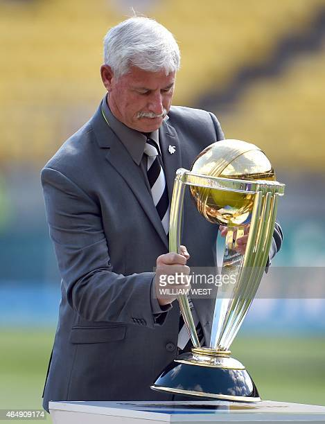 In this picture taken on March 1 New Zealand cricket legend Richard Hadlee carries the Cricket World Cup trophy before the start of the 2015 Cricket...