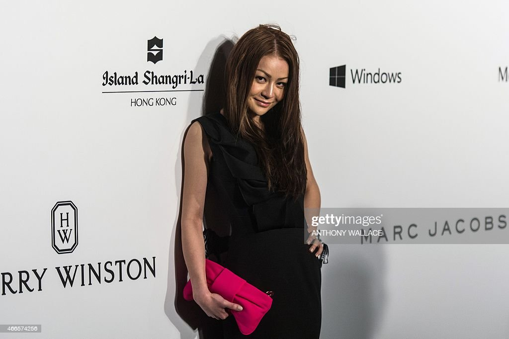 In this picture taken on March 14, 2015, Leung Chai-yan, 23, daughter of Hong Kong Chief Executive Leung Chun-ying poses on the red carpet during the 2015 amfAR Hong Kong gala at Shaw Studios in Hong Kong. Hong Kong's leader Leung Chun-ying was forced to make an official statement about his daughter's health on March 17 after she posted a number of alarming messages on her Facebook page.