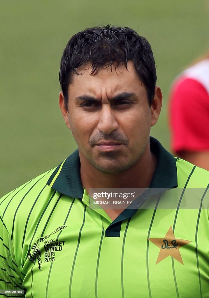 In this picture taken on March 4, 2015, Pakistan's <a gi-track='captionPersonalityLinkClicked' href=/galleries/search?phrase=Nasir+Jamshed&family=editorial&specificpeople=4819500 ng-click='$event.stopPropagation()'>Nasir Jamshed</a> lines up for the national anthems during the Pool B Cricket World Cup match between United Arab Emirates and Pakistan at McLean Park in Napier. AFP PHOTO / Michael Bradley