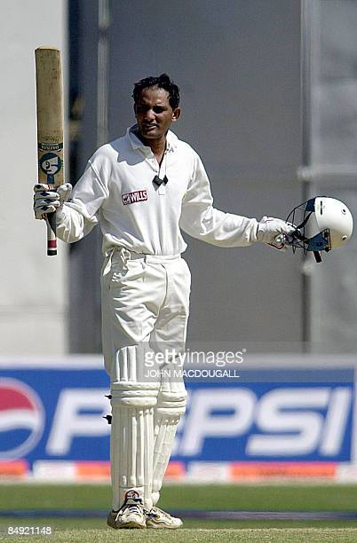 In this picture taken on March 6 Indian cricketer Mohammad Azharuddin salutes the crowd after completing a century on the final day of the second...