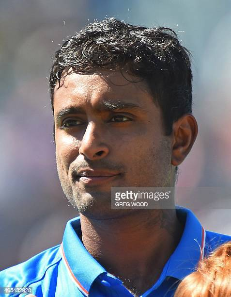In this picture taken on March 6 India's Ambati Rayudu listens to the national anthem prior to the start of the 2015 Cricket World Cup Pool B match...