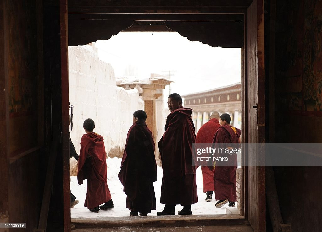 In this picture taken on March 9, 2012 Tibetan monks leave after taking part in a ceremony at Lajia Monestry in China's northwest Qinghai province. Overseas rights groups say three Tibetans have self-immolated in China in recent days as Beijing tightens security ahead of the sensitive anniversary of deadly 2008 riots. AFP PHOTO/Peter PARKS