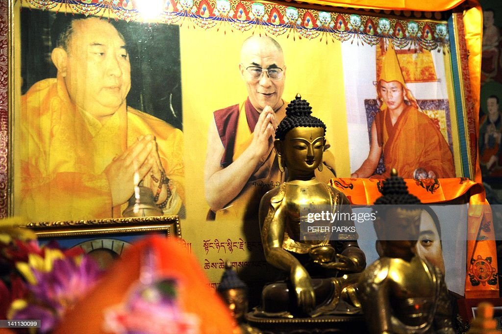 In this picture taken on March 9, 2012, pictures of the Dalai Lama are seen at Lajia Monestry in China's northwest Qinghai province. Overseas rights groups say three Tibetans have self-immolated in China in recent days as Beijing tightens security ahead of the sensitive anniversary of deadly 2008 riots. AFP PHOTO/Peter PARKS