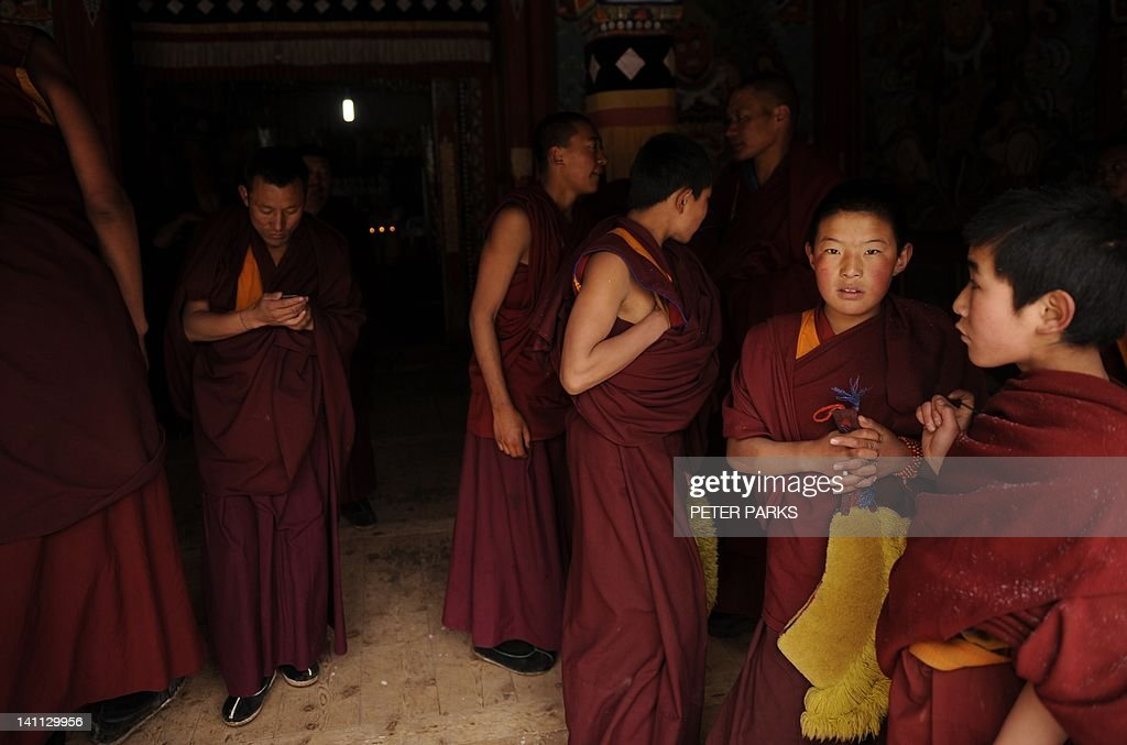 In this picture taken on March 9, 2012, Tibetan monks leave after taking part in a ceremony at Lajia Monestry in China's northwest Qinghai province. Overseas rights groups say three Tibetans have self-immolated in China in recent days as Beijing tightens security ahead of the sensitive anniversary of deadly 2008 riots. AFP PHOTO/Peter PARKS