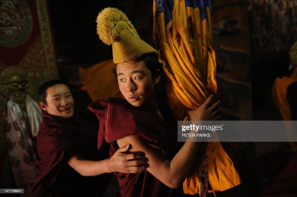 In this picture taken on March 9, 2012, young Tibetan monks take part in a ceremony at Lajia Monestry in China's northwest Qinghai province. Overseas rights groups say three Tibetans have self-immolated in China in recent days as Beijing tightens security ahead of the sensitive anniversary of deadly 2008 riots. AFP PHOTO/Peter PARKS