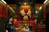 In this picture taken on May 10 a woman burns incense sticks at a temple to celebrate the Tin Hau festival in Hong Kong Worshippers visit temples...