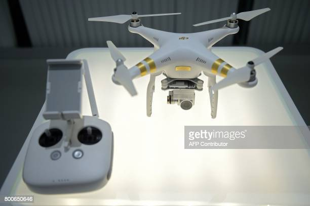 In this picture taken on May 11 a drone is seen in the showroom of the DJI headquarters in Shenzhen China dronemaker DJI is betting on flying...