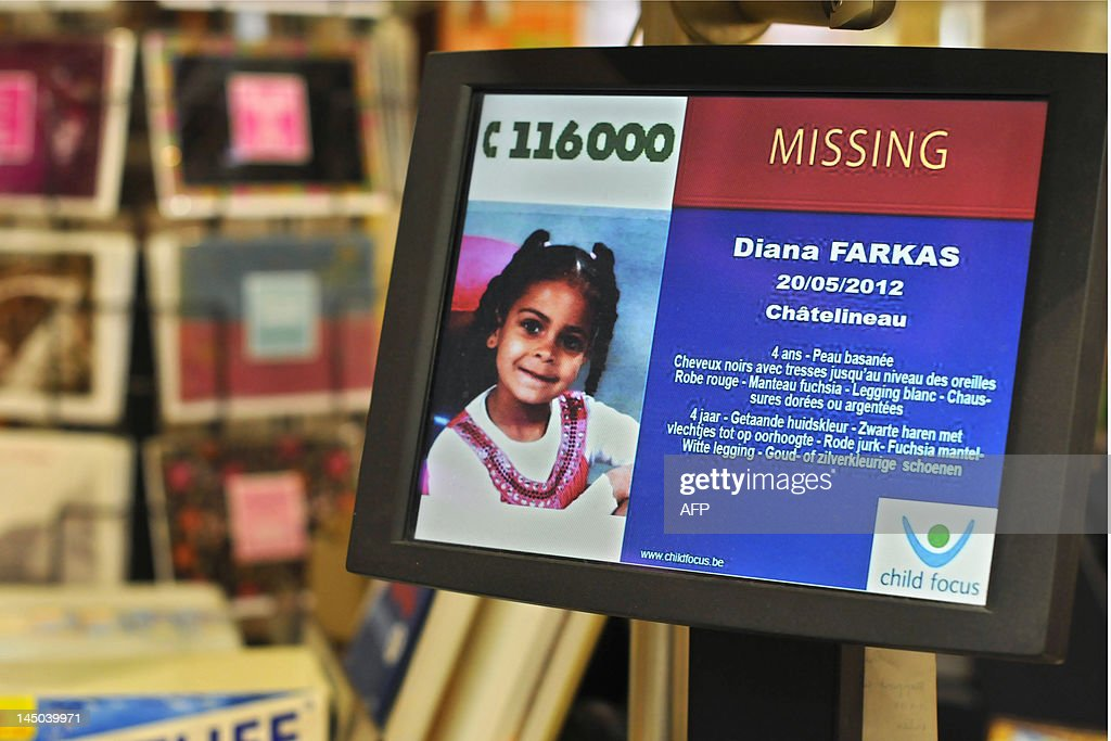 In this picture taken on May 23, 2012 a missing persons bulletin regading four year old Diana Farkas, who has been missing since May 21, 2012 is displayed at a sales point of the Belgian National Lottery in Leuven. The mother of four year old Dianar first claimed she had left the child at school in the morning, and came back in the afternoon to find her daughter missing. After interrogation by the police, she now claims the girl went missing in Chatelinau when she left her daughter in the car when she went shopping.