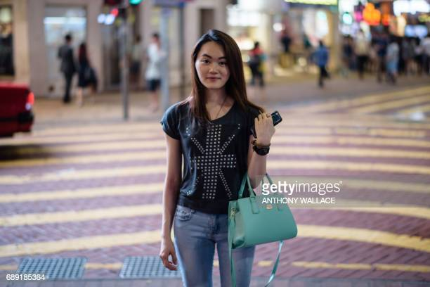 In this picture taken on May 24 Charlene who works in property management poses while wearing a Tshirt with a British national flag design in Hong...