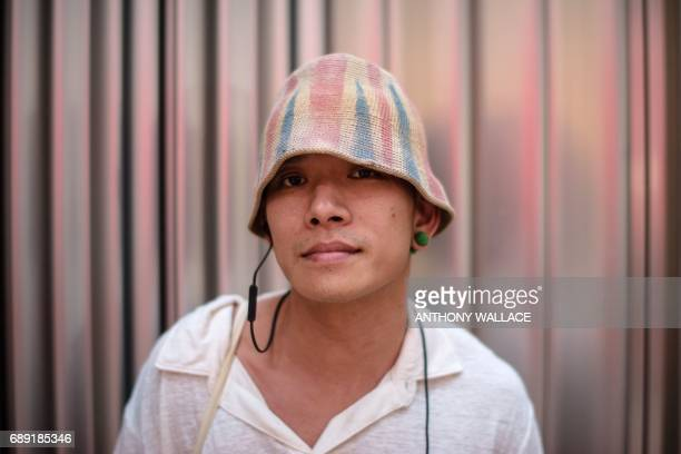 In this picture taken on May 24 Ivan a 43yearold hairstylist poses while wearing a hat which he designed with a British national flag on a street in...
