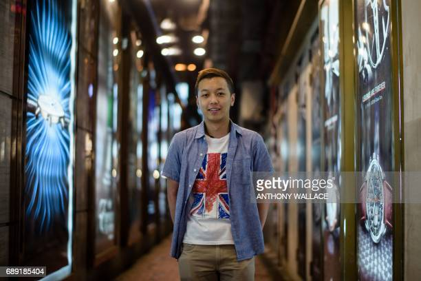 In this picture taken on May 24 Mingo a 27yearold bar manager poses while wearing a Tshirt with a British national flag design in Hong Kong When...