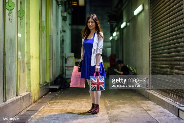 In this picture taken on May 24 Rema an IT worker in her 30s poses with her Marks Spencer shopping bag with a design of the British national flag in...