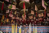 In this picture taken on May 25 a devotee prepares to pray at a temple for Tin Hau the Goddess of the Sea during the 'Bun Festival' on the island of...