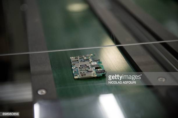 In this picture taken on May 8 a smartphone chip component circuit is seen at the Oppo factory in Dongguan Chinese smartphone maker Oppo began life...