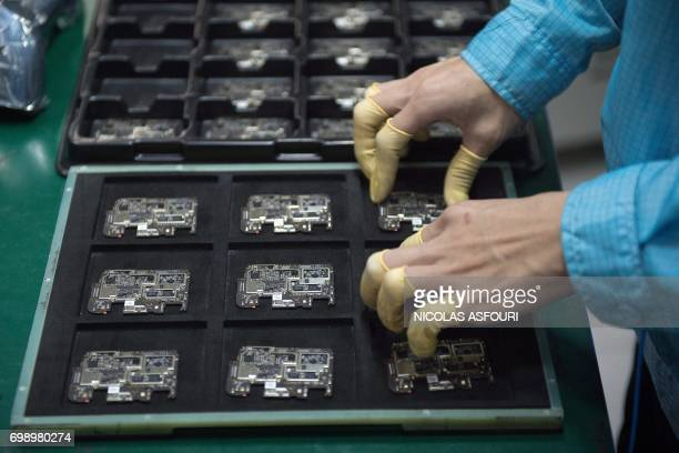 In this picture taken on May 8 a worker checks chip component circuits at the Oppo factory in Dongguan Chinese smartphone maker Oppo began life...