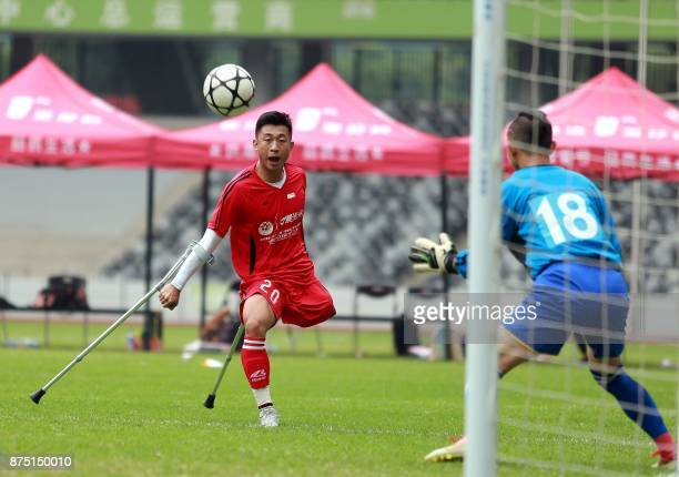 In this picture taken on November 12 He Yiyi kicks the ball during a football match with a local team in Guangzhou Guangdong province The exploits of...