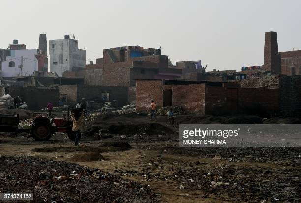In this picture taken on November 13 waste from brass factories is seen dumped on the banks of Ramganga river in Moradabad In the northern Indian...