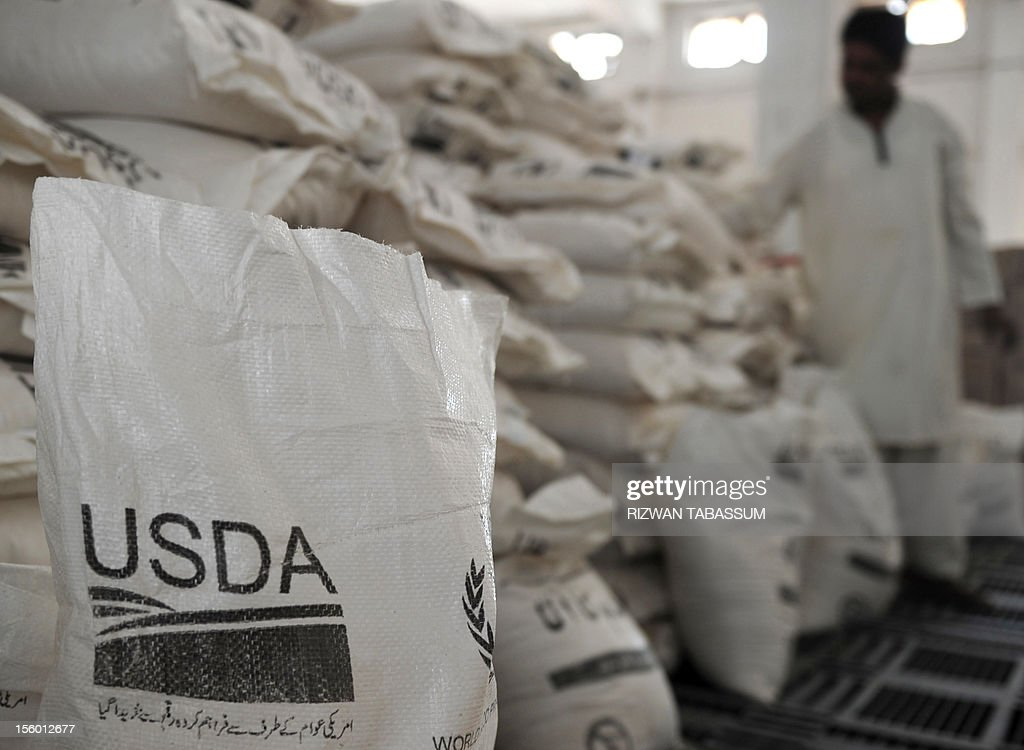 In this picture taken on November 2, 2012, a Pakistani worker arranges aid supplies at the World Food Programme (WFP) supply centre at Mirali Village in Jacobabad district, around 500 kilometres (300 miles) north of the metropolis of Karachi. While the United States recovers from superstorm Sandy, away from the glare of the international media, five million Pakistanis are struggling to get by in the country's third successive year of massive floods. Two years after the worst floods in Pakistan's history captured the world's attention, this summer's monsoon rains once again inundated huge areas of the Indus Valley, with rural parts of Sindh province the worst hit. AFP PHOTO/Rizwan TABASSUM