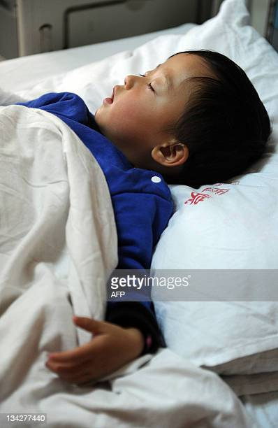 In this picture taken on November 28 a child with hepatitis C rests on a hospital bed in Hefei east China's Anhui province More than 150 Chinese...