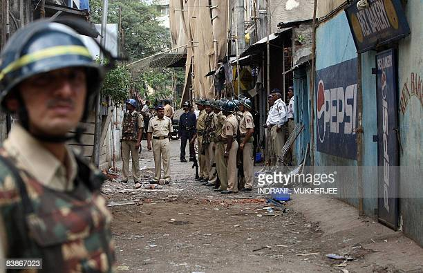 In this picture taken on November 30 2008 an Indian policeman guards the entrance to the Nariman House Jewish centre in Mumbai As stated in a story...